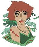 一件绿色礼服的红头发人女孩有叶子的 免版税库存图片