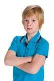 一件蓝色衬衣的体贴的男孩 库存照片