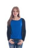 一件蓝色T恤杉和牛仔裤的女孩 免版税库存图片