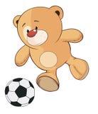 一头被充塞的玩具小熊足球运动员动画片 免版税库存照片