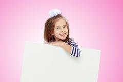 一件镶边礼服的小女孩 库存照片