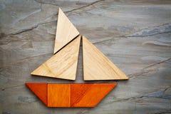 从七巧板难题的抽象风船 图库摄影