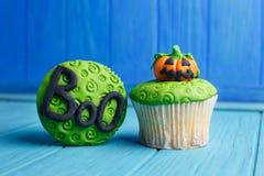 万圣夜党甜点 与pumpki的可口万圣夜杯形蛋糕 图库摄影