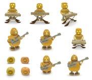 万圣夜南瓜音乐家(低音吉他弹奏者,键盘乐器演奏家) 免版税库存照片