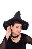 万圣夜巫婆听着您 免版税库存图片