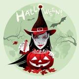 万圣夜巫婆用糖果和南瓜 免版税库存图片