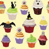 万圣夜杯形蛋糕传染媒介例证明亮的五颜六色的样式 免版税库存照片