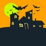 万圣夜老房子橙色天空和月亮 库存照片