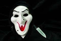 万圣夜鬼魂与刀子的面罩 图库摄影