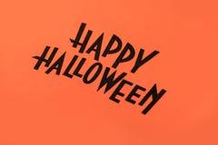 万圣夜黑商标在橙色背景绘了 免版税库存照片