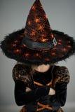 万圣节当事人 图象的女孩邪恶的巫师 库存照片