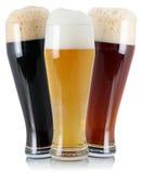 三与泡沫的不同啤酒 免版税库存照片