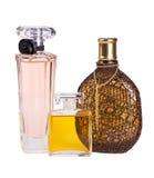 在白色香水隔绝的三个瓶 免版税库存图片