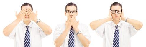 三个人姿势以他们的手盲目性, speechles 库存照片