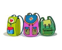 三个传染媒介五颜六色的儿童背包 库存图片