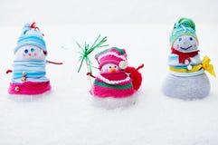 三个冬天雪人 库存图片