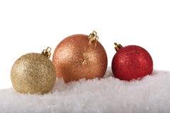 三个发光的圣诞节球 库存图片