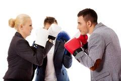三个商人佩带的拳击手套起动竞争战斗 免版税库存图片