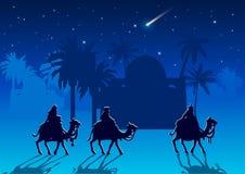三个圣人在他的诞生以后拜访耶稣基督 免版税库存照片