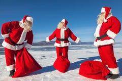 三个圣诞老人条目会议  库存照片