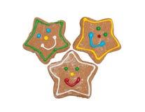 三个圣诞节姜饼星形曲奇饼 库存照片