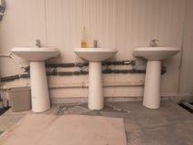 三个垫座水槽行  免版税图库摄影