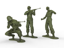 三个塑料小锡兵 免版税库存照片