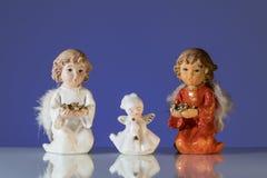 三个天使特写镜头由瓷制成 免版税库存图片
