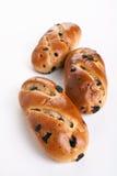 三个小圆面包用葡萄干 库存照片