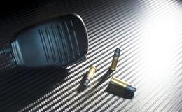 三个弹药筒和话筒 库存图片