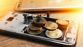 三个微型微型图与在机动性保留金钱 Cashles 库存照片