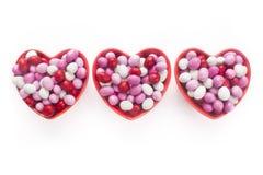 三个心形的糖果盘 免版税库存照片