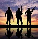 三个恐怖分子剪影  库存图片