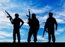 三个恐怖分子剪影  免版税库存照片