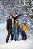 三个愉快的男孩在森林里 免版税图库摄影