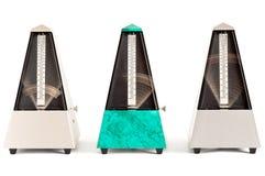 三个摇摆的金字塔节拍器 免版税库存照片