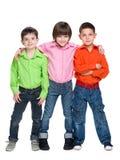 三个时尚年轻人男孩 免版税库存图片