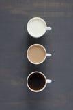 三个杯子用牛奶和咖啡 免版税库存照片