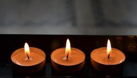 三个灼烧的教会蜡烛 免版税库存图片