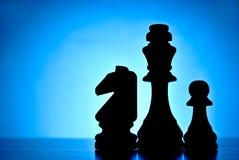 三个现出轮廓的棋子 免版税库存图片