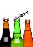 三个瓶啤酒和开启者 库存照片