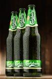 三个瓶嘉士伯啤酒 免版税库存照片