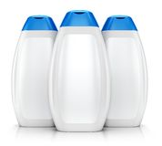 三个白色塑料瓶香波 库存照片
