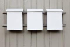 三个白色邮箱 库存照片