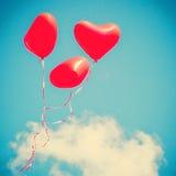 三个红色心形的气球 免版税库存照片