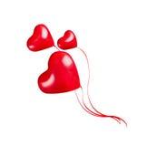 三个红色心脏气球,隔绝在白色 库存照片