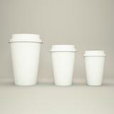三个纸咖啡杯 库存图片