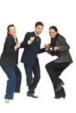 三个组商人跳舞 免版税图库摄影