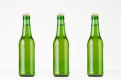 三个绿色longneck啤酒瓶330ml,嘲笑  库存图片