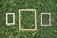 三个老木制框架 库存图片